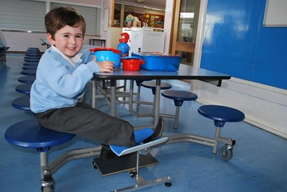 Rio using his leg support at School