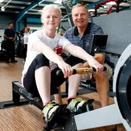 Louise Allen taking part in a sponsored marathon row for St David's Hospice