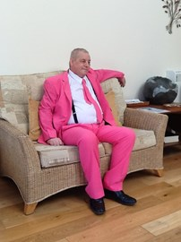 John showing off his suit in the Heart of Kent Hospice