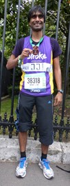 Me completing my first marathon in Paris 2014