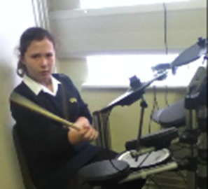 Sacha Playing the drums at school