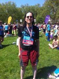 Daniel wearing his Bupa 10K Medal