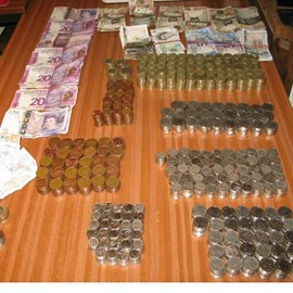 The cash donations neatly stacked & counted