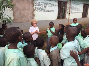 Charlie meeting the Kiteghe children.