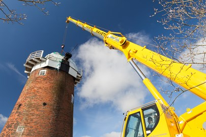 Crane preparing to lift the cap from Horsey Windpump