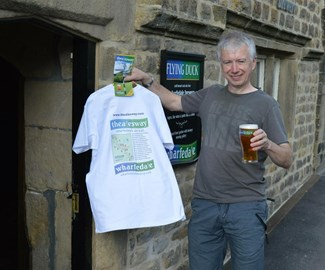 Mark Selby with a pint of Wharfedale Blonde and The Ales Way souvenir t-shirt