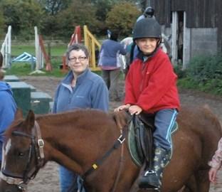 Sam riding Evie (more like Eeyore)