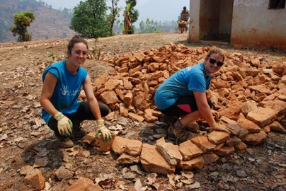 Helping with the rubble clearing of a remote school