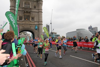 Tammy running past NSPCC cheer point at Tower Bridge