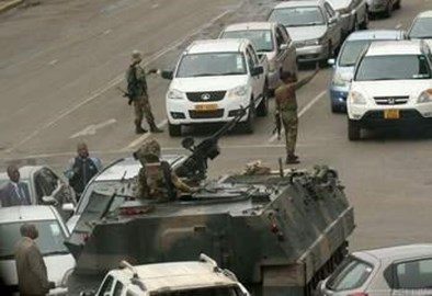 Soldiers stop traffic in Harare.