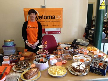 Jemma with Cakes. The Cake Bake event at The History Press raised £136.77. Well done everyone!
