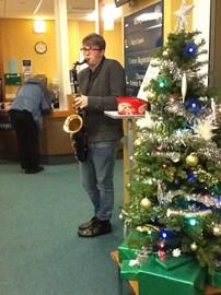 Josh Carr plays sax for Helen House