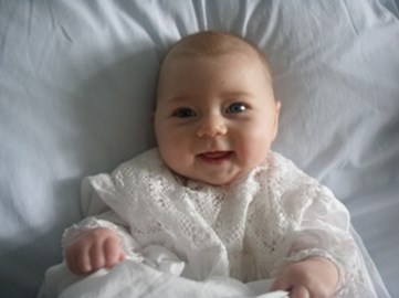 Anna in her christening gown