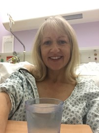 Jackie in her Hospital bed waiting for a Dishy Doc Selfie to raise money for MIACS