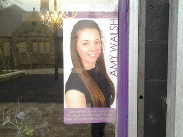 Amy in Serenity Hair & Beauty shop window
