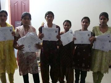 Computer students show certificates