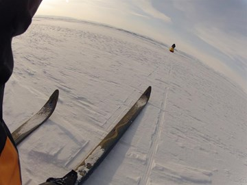 Skiing across the frozen sea ...