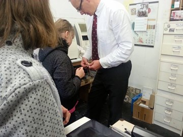 Nastia helping make her glasses at Large and Large Opticians after they tested her and identified she needed glasses.  The tests and glasses were donated by Mr Large the option in.