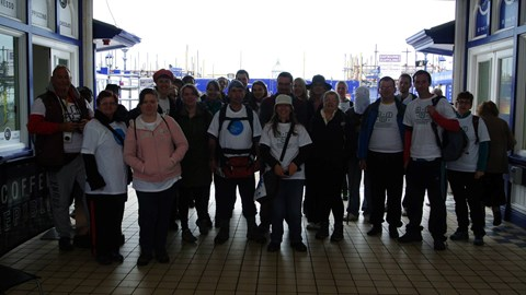 Pier to Pier Coastal walkers just about to leave Eastbourne Pier