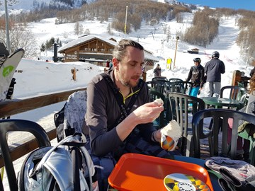 Greg eating well while snowboarding