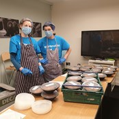 Rachael and Chloe packing up meals to deliver to communities in need and frontline workers