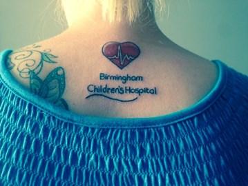 Lisa Parker tattoo on her back 30/6/14
