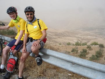 With Gavin on our 2009 bike ride in the Jordan Valley. Check out those legs!