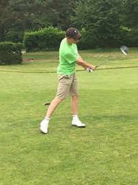 Charlie teeing off at the beginning of his sixth and final round