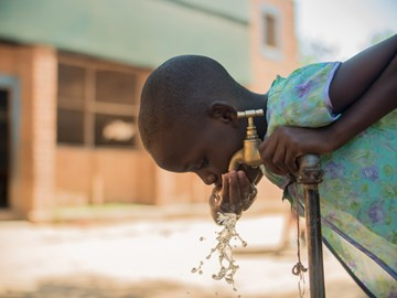 The One Foundation brings clean, safe water to communities such as this one in Malawi.