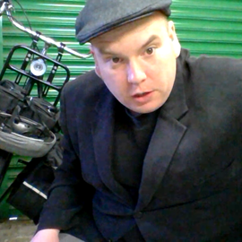 A heavy man and his heavy Dutch bike, itching to ride to the Netherlands