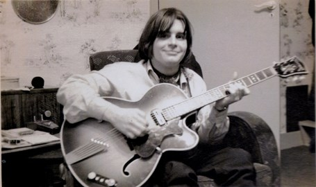 Early days with his beloved guitar