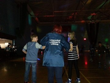 Marian (volunteer area coordinator and Portsmouth and Hayling Island Link chair lady) at a roller disco where Vika and Dennis were helping her skate!