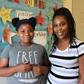 Shanaria with her daughter Jada, who receives a BackPack each week at school.