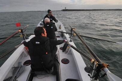 4 men in a boat