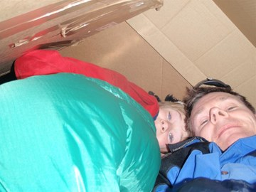 Me and Josh inside our cardboard shelter