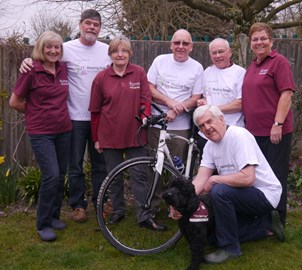 Cyclists, supporters and Hearing Dog Puppy Isaac