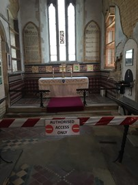 The chancel, considered unsafe, is now cordoned off