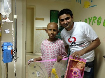 Tariq with a patient