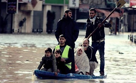 Rescue workers helping children and the elderly to escape the floods!