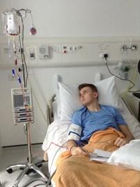Tom watching his bone marrow transplant be transfused