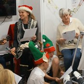 Patients and staff enjoy a Christmas musical sing along.