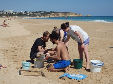 Working with European Service Volunteers on the beach in Alvore, Portugal