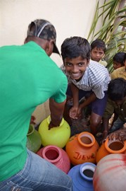 The first pots of safe water are filled