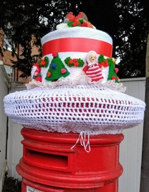 The Christmas Cake Post Box in The High Street in Barley