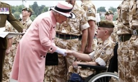 shaun 2010 three months after stepping on IED receives medal from the Queen