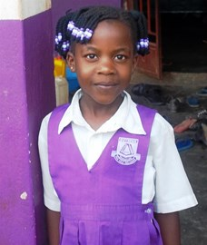 A pupil in her uniform shows off the lovely school colours