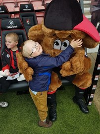 With AFCB's Cherry bear