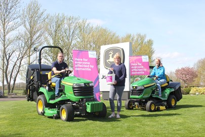 Andy Maxfield, Karen Maxfield and Kathryn Maxfield with the John Deere Lawn Tractors X950R  and X350R