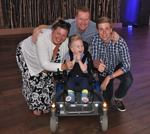 Noah with Lucie, Me and Matt and a massive smile