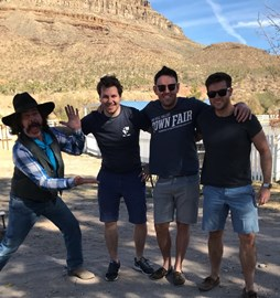 The trio on their last road trip in Arizona, and a cowboy (far left)